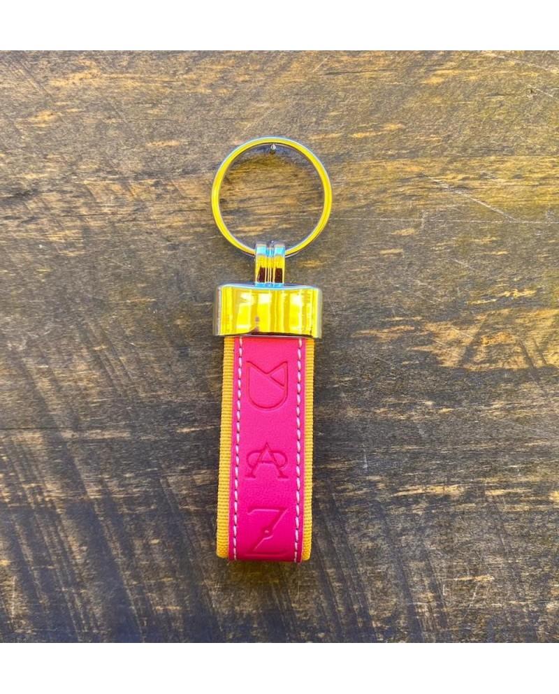Llavero ganaderías piel rosa y amarillo